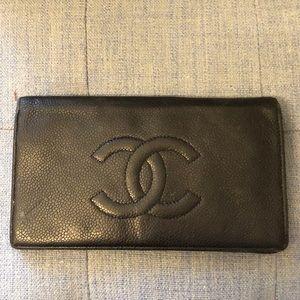 Black Chanel caviar leather wallet CC logo